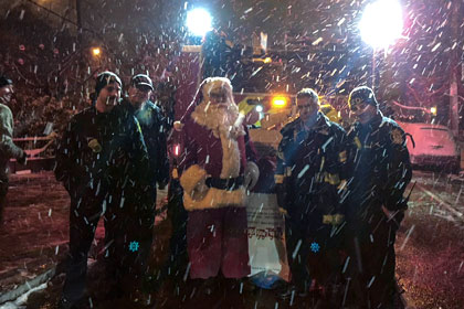Santa and Firefighters in the Snow